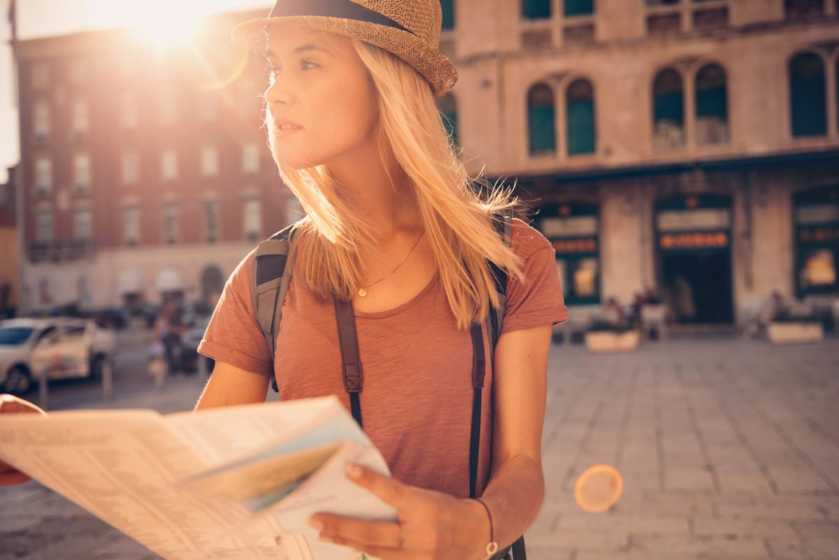 Young woman traveling the world