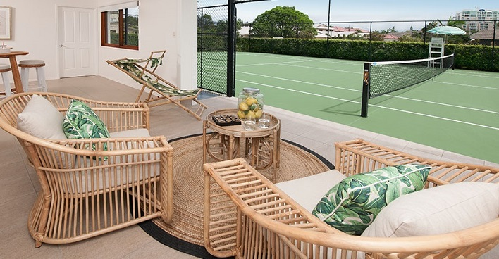 Lounge area looking onto tennis court