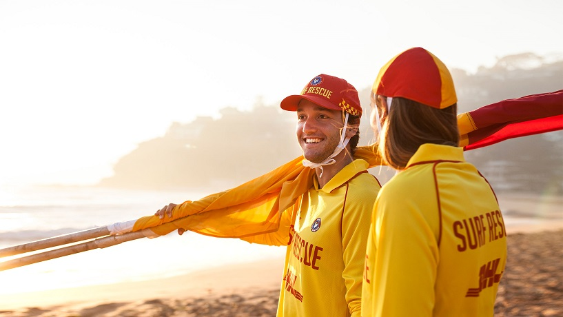 Two Surf Life Savers on the beach.