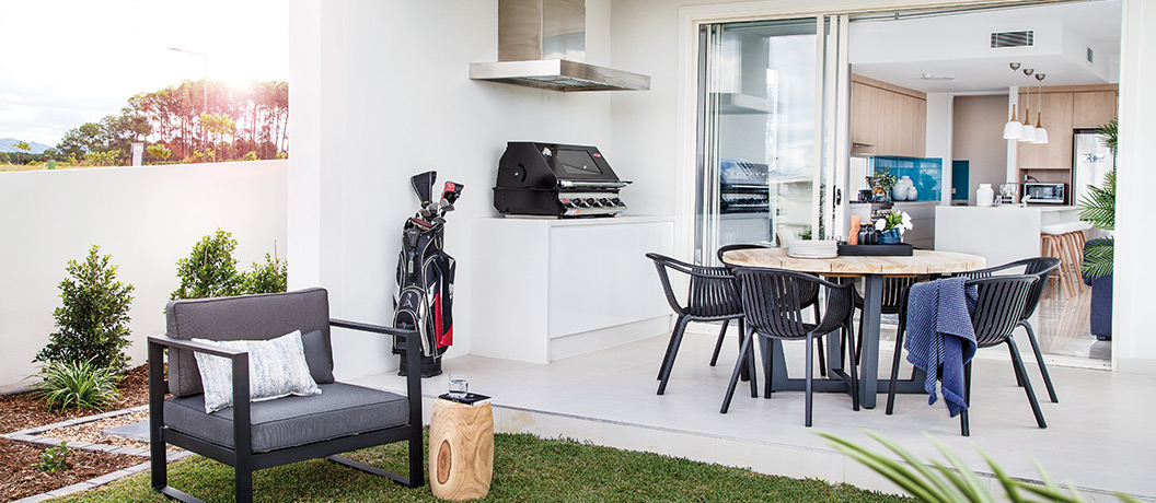 Alfresco outdoor entertaining area with barbeque and seating,
