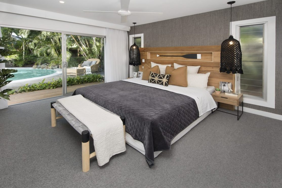 Master bedroom with view of outdoor area