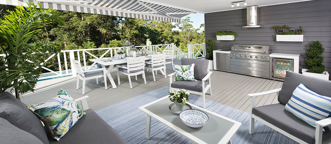 Alfresco outdoor dining area with BBQ and pool view