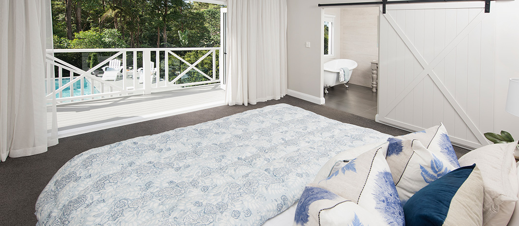 Master bedroom suite with ensuite and balcony to pool deck