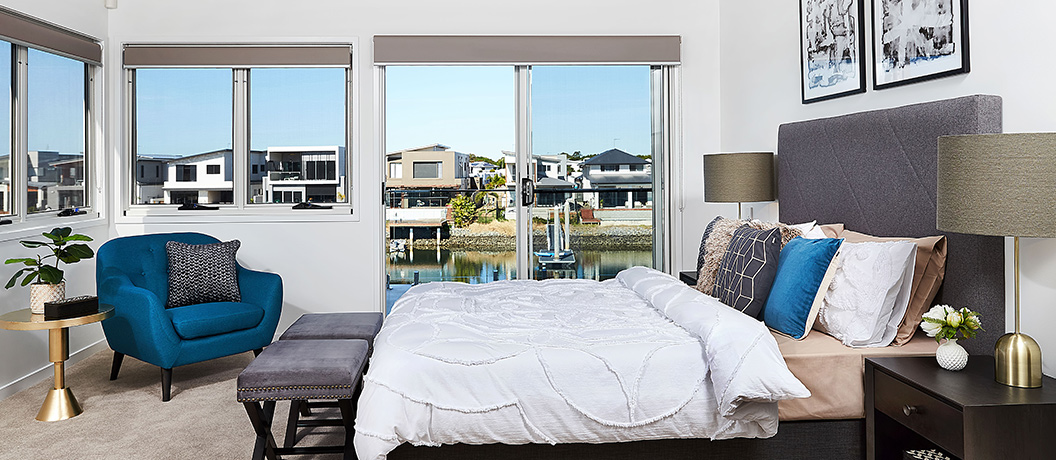 Spacious master suite with canal views from balcony.