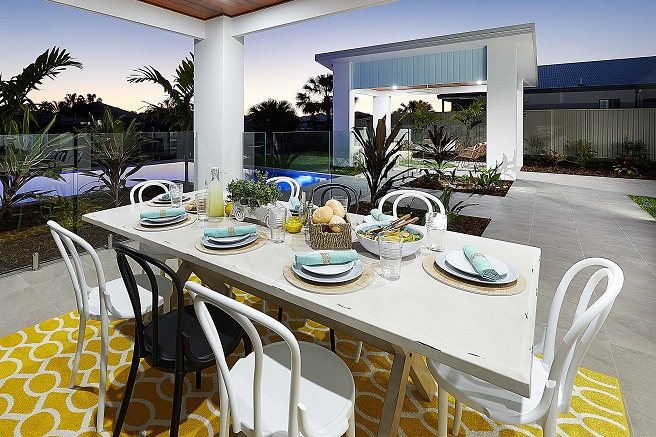 Outdoor dining table with pool view