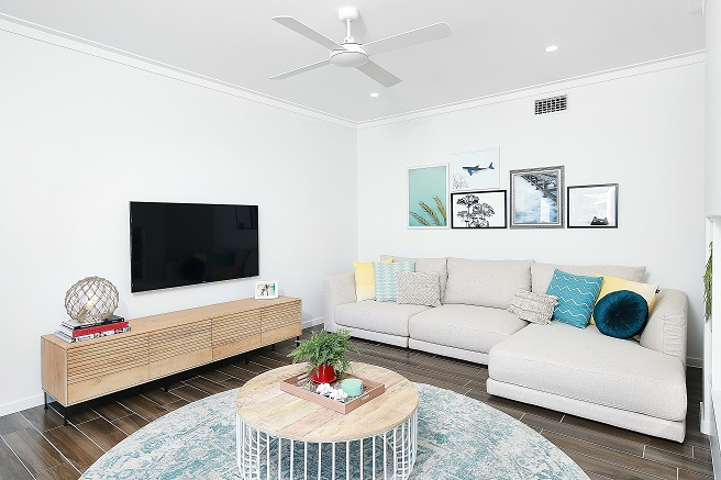 Living area with TV and ceiling fan