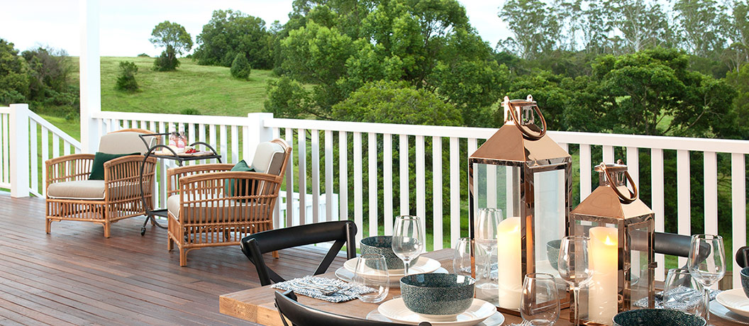 Deck with comfortable decor and accessories.