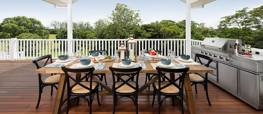 Deck with BBQ and table.