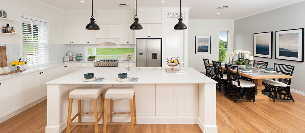 Modern kitchen with island and table setting.