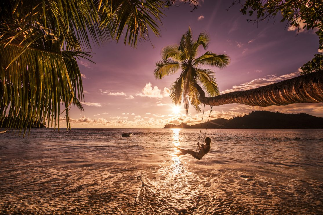 The Seychelles beach with sunset.